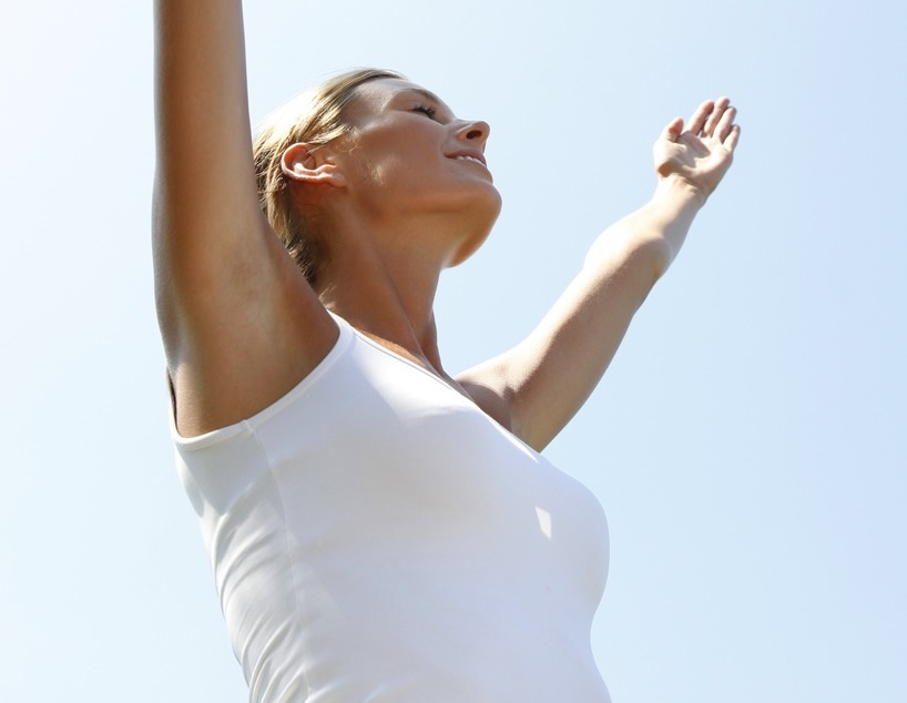 Woman doing relaxation exercising, stretching arms up